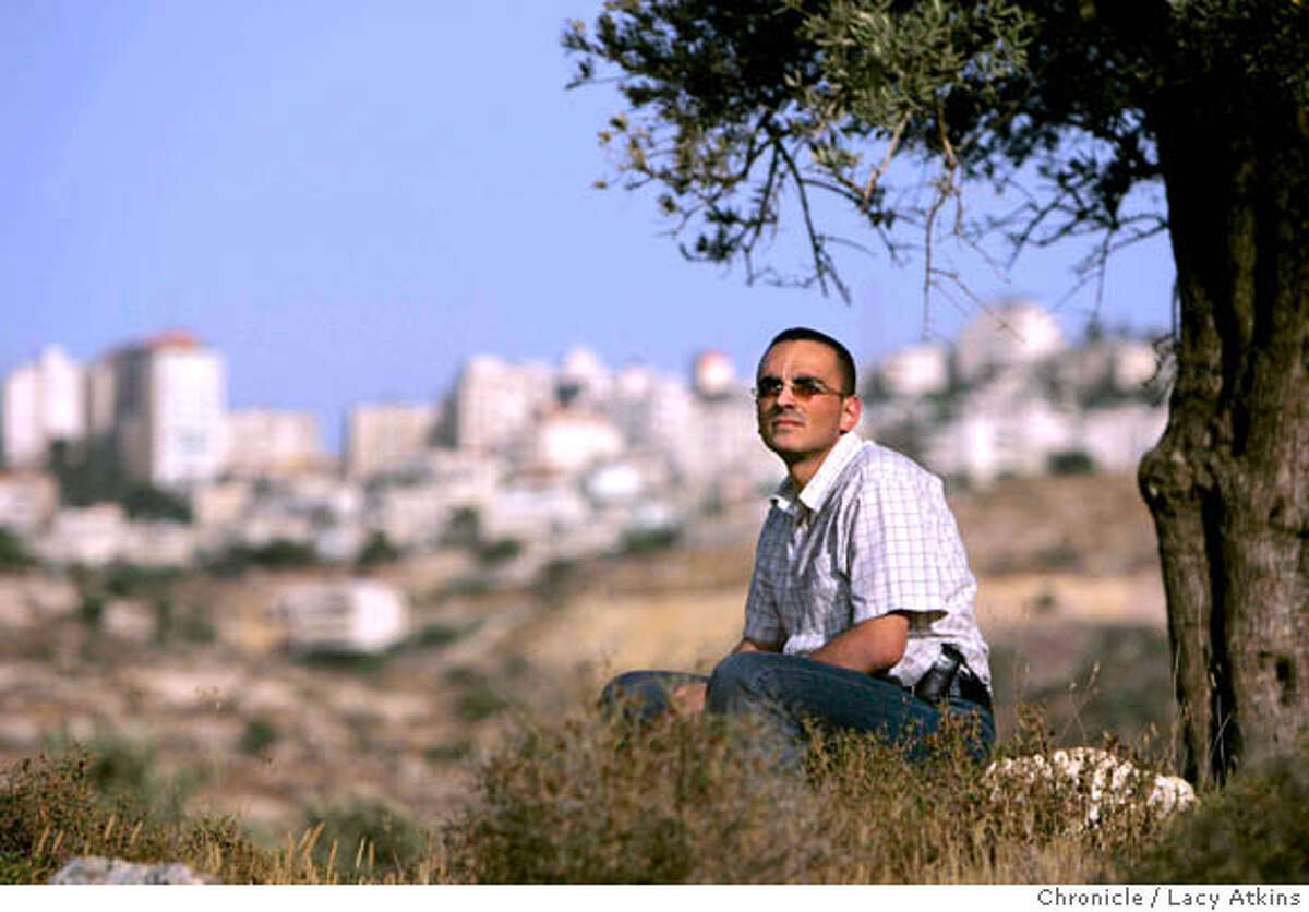 Khalad Salameh, while sitting under an Olive Tree overlooking Ramallah, June 20, 2005, in Israel he remembers as a child the Israeli taking his fathers olive tree orchard away. He was at home with mother Faheemeh and sister Rawa . Photographer Lacy Atkins