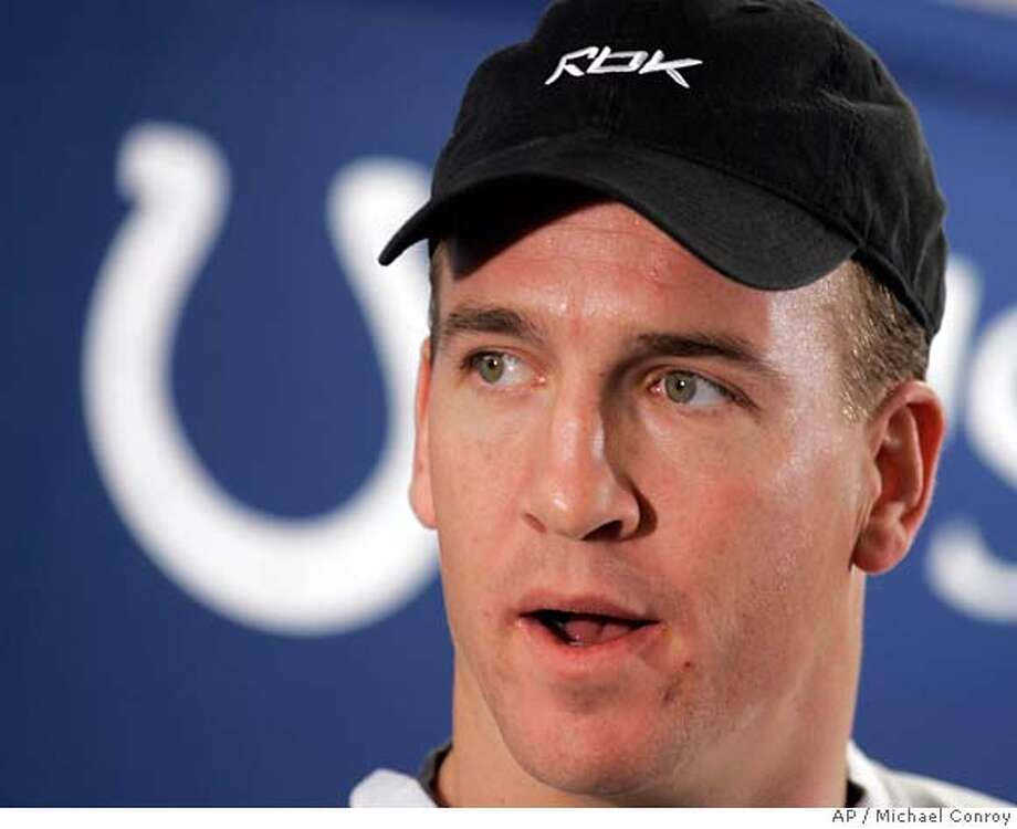 Indianapolis Colts quarterback Peyton Manning answers a question during a press conference at the Colts football practice facility in Indianapolis, Wednesday, Jan. 24, 2007. The Colts face the Chicago Bears in Super Bowl XLI in Miami on Sunday, Feb. 4. (AP Photo/Michael Conroy) Photo: Michael Conroy