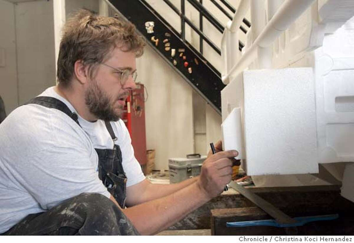 CHRISTINA KOCI HERNANDEZ/CHRONICLE Andrew Junge works on his styrofoam Hummer. Sunset Scavenger, SF's garbage company, has an artist in residence program and a studio at the Tunnel Road dump site where the artists use the discards to create art. They're having an art opening on Friday, and we want a 2-3 photo stand alone package to advance it.