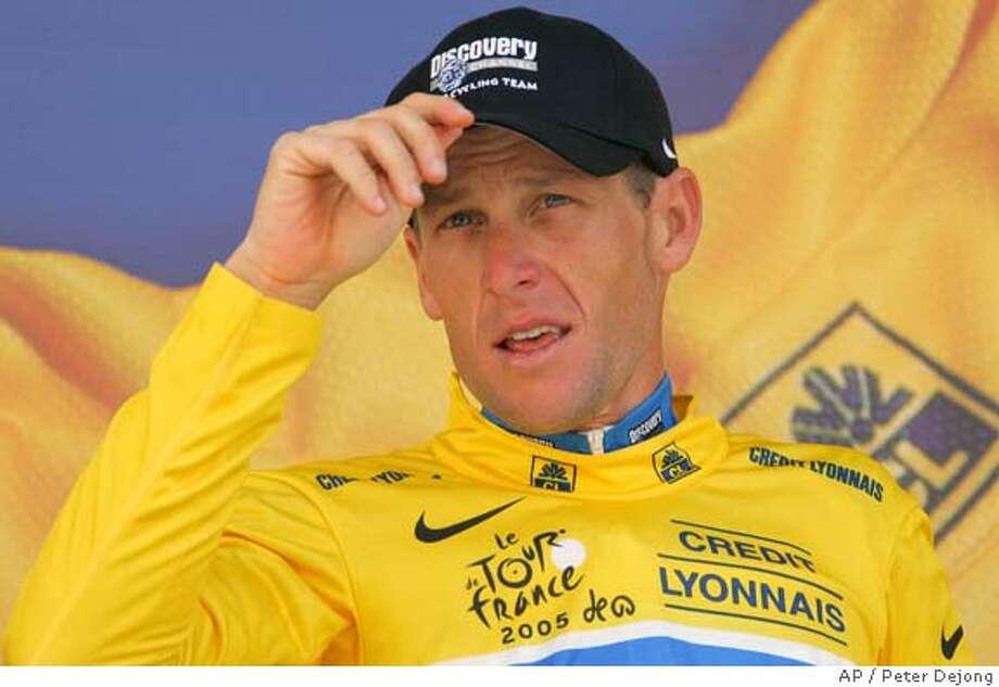 Overall leader Lance Armstrong, of Austin, Texas, adjusts his cap on the podium after the 19th stage of the Tour de France cycling race between Issoire and Le Puy-en-Velay, central France, Friday, July 22, 2005. (AP Photo/Peter Dejong) Photo: PETER DEJONG