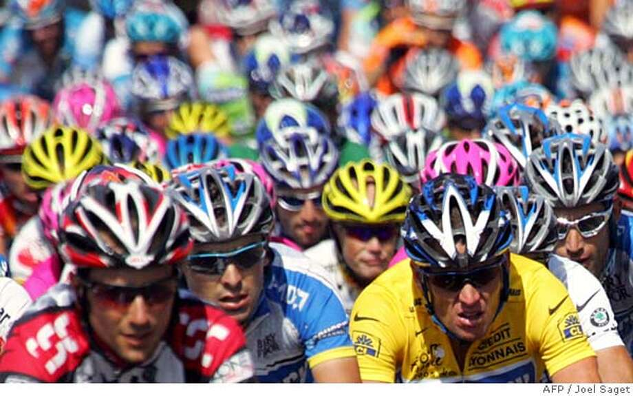 Yellow jersey US Lance Armstrong (Discovery Channel/USA) rides in the pack during the 19th stage of the 92nd Tour de France cycling race between Issoire and Le-Puy-en-Velay, 22 July 2005. AFP PHOTO JOEL SAGET (Photo credit should read JOEL SAGET/AFP/Getty Images) DV Photo: JOEL SAGET