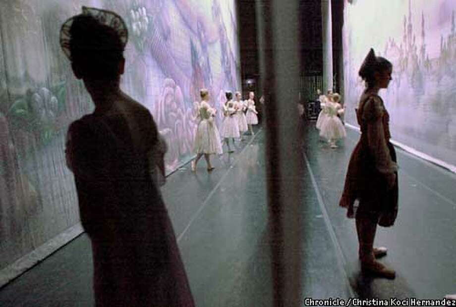 "EBNUTCRACKc-C-11DEC01-EF-CKH  CHRISTINA KOCI HERNANDEZ/CHRONICLE  Oakland Ballet dancers wait on stage at the Paramount Theater, in Oakland, for the curtain to rise, to begin act two of the Nutcracker. In foreground are ""Spanish Chocolate"" and in background are ""Sugar Angels."" the Sugar Angels are not members of the company, but rather youth dancers chosen for these small roles. Photo: CHRISTINA KOCI HERNANDEZ"