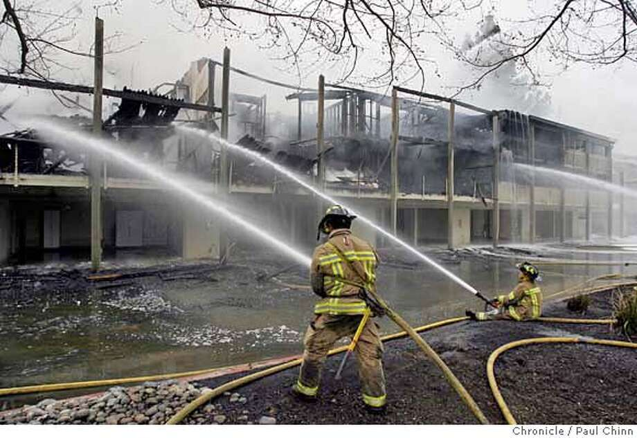 Contra Costa County firefighters work to control a major fire at the Rossmoor retirement community in Walnut Creek, Calif. on Friday, Jan. 26, 2007. About 12 apartments were destroyed in the mid-afternoon blaze.  PAUL CHINN/The Chronicle Photo: PAUL CHINN