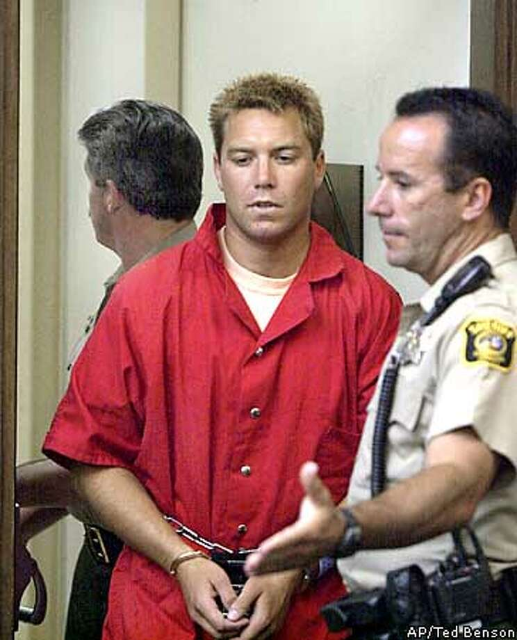 Scott Peterson is led into Stanislaus County Superior Court for arraignment in the deaths of his wife Laci Peterson and unborn son, Conner, April 21, 2003 in Modesto, California. Peterson, a man who claimed his pregnant wife Laci mysteriously vanished from their home last Christmas Eve while walking the dog, pleaded not guilty on Monday to two charges of premeditated murder, for allegedly killing her and their unborn son. Peterson told a judge he did not kill his 27-year-old wife and requested a public defender because he said he did not have enough money to hire a private attorney. REUTERS/POOL/Ted Benson Photo: POOL