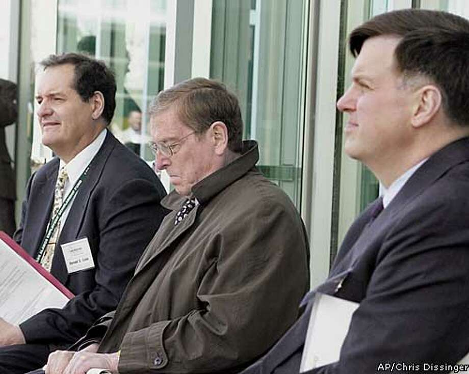 Donald Cobb of Los Alamos National Laboratory, left, Sen. Pete Domenici, R-N.M., center, and laboratory Interium Director George P. Nanos, attend the dedication of the Nonproliferation and International Security Center (NISC) at Los Alamos National Laboratory Tuesday, April 22, 2003, in Las Alamos, N.M. The dedication is part of the 60th Anniversary events this week at Los Alamos. (AP Photo, Los Alamos Monitor, Chris Dissinger) Photo: CHRIS DISSINGER