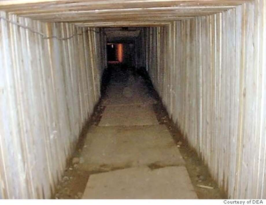 A photo released by the United States Drug Enforcement Agency on July 21, 2005 shows the tunnel dug by drug traffickers across the U.S.-Canada border in Aldergrove, British Columbia. Three people have been arrested after police raided a sophisticated tunnel intended to smuggle drugs under the U.S.-Canada border between Vancouver and Seattle, police said on Thursday. The smugglers spent more than a year building the 360-foot (110-metre) long tunnel that ran from a Quonset hut-style storage building on a property near Aldergrove, British Columbia to the living room of a home in Lyndon, Washington, investigators said. REUTERS/United States DEA/Handout Photo: HO