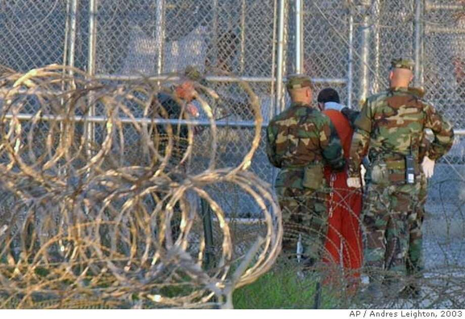 A detainee is returned to his cell at Camp X-Ray at the U.S. naval base in Guantanamo Bay, Cuba on Thursday, Feb. 28, 2002. (AP Photo/Andres Leighton) ALSO RAN 7/13/03 Ran on: 07-23-2005  A detainee is returned to his cell at the U.S. military base at Guantanamo Bay, Cuba. Photo: ANDRES LEIGHTON