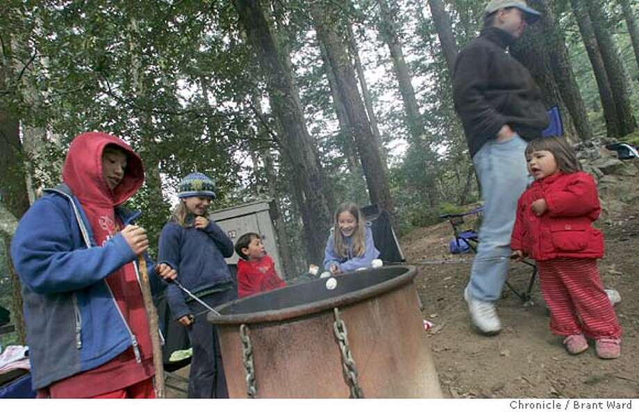 camping675_ward.jpg  The Karp and Agoglia families from Mill Valley and San Francisco joined forces on their campsite. The kids wanted to roast marshmallows first thing in the morning...while the parents were counting on a more traditional breakfast.  Memorial Day weekend was a busy time at Mount Tamalpais. Campers at the Pan Toll campground were mostly families from around the Bay Area. There are only 16 campsites here, but there is good space between tentsites. Reservations are not taken, the spaces are handed out on a first-served basis.  Brant Ward 5/30/05 Ran on: 07-15-2005  Kids from the Agoglia and Karp families roast marshmallows in the early morning at a Mount Tamalpais campsite. Ran on: 07-15-2005  Kids from the Agoglia and Karp families toast marshmallows at a Mount Tamalpais campsite. Photo: Brant Ward