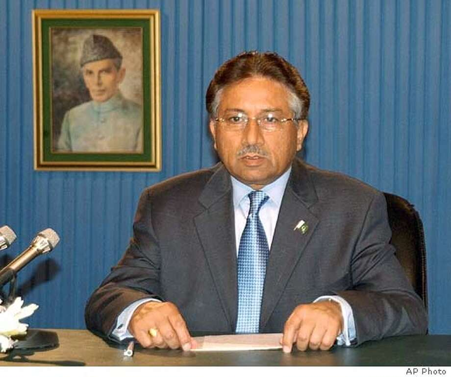 In this picture released by the Press Information Department, Pakistan President Gen. Pervez Musharraf addresses the nation on Pakistan Television, Thursday, July 21, 2005 in Islamabad, Pakistan. Musharraf vowed to fight religious extremism, and said militants like those who carried out the London bombings were defaming Islam. Portrait of Pakistan's founder Mohammad Ali Jinnah seen on left. (AP Photo / Press Information Department,ho) PICTURE RELEASED BY THE PRESS INFORMATION DEPARTMENT