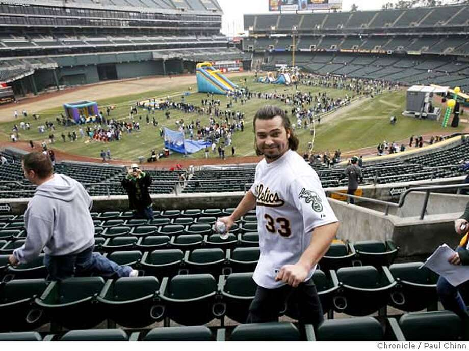 Outfielder Nick Swisher walks through the second deck to greet fans at the Oakland A's Fanfest event at McAfee Coliseum in Oakland, Calif. on Saturday, Jan. 27, 2007.  PAUL CHINN/The Chronicle  **Nick Swisher fanfest28 Photo: PAUL CHINN