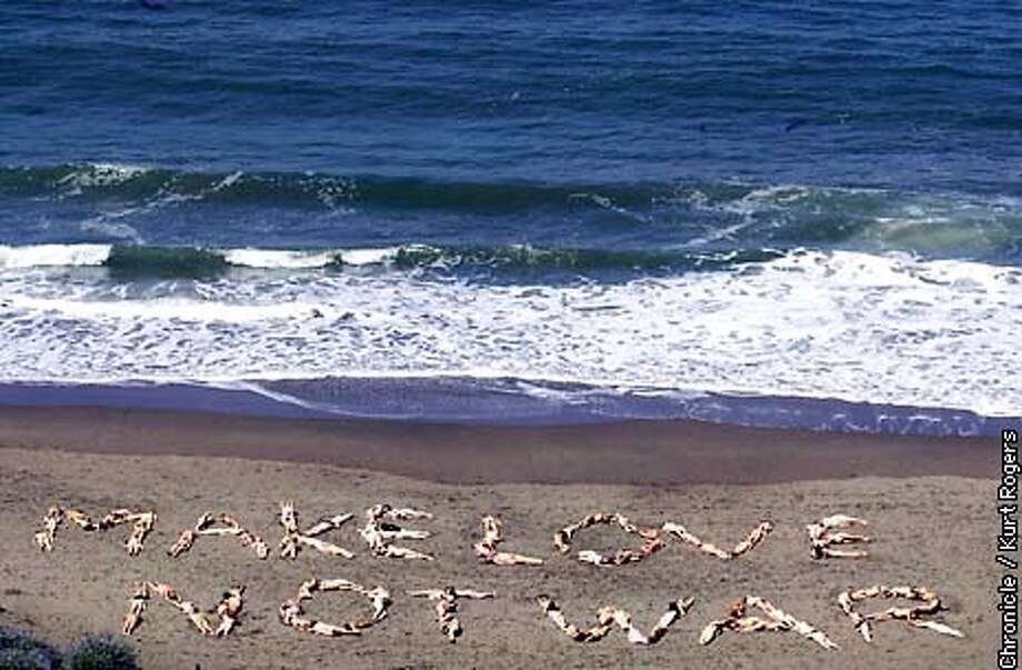 About 100 couples Got naked and Spelled out Make Love Not War on Baker beach .Photo By Kurt Rogers Photo: Kurt Rogers