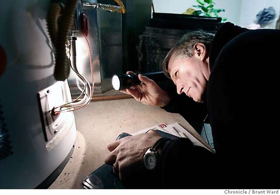 .JPG  Skip Walker checks out the water heater and furnace in the garage area of a Bayview home. He's pleased to see the appliances are almost new.  Skip Walker is a home inspector. He recently inspected a home going on the market in the Bayview district of San Francisco.  {Brant Ward/San Francisco Chronicle}1/9/07 Photo: Brant Ward
