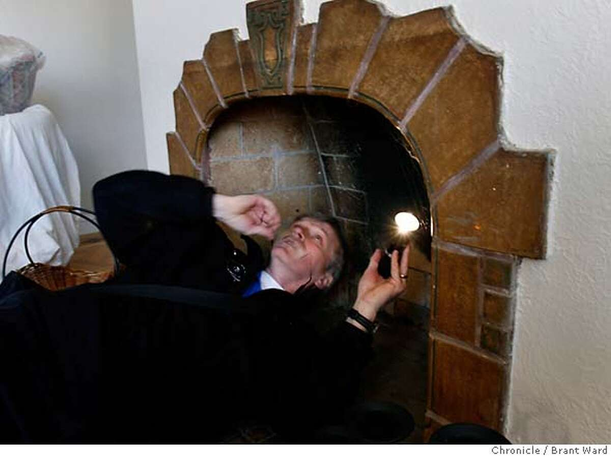 inspect017.JPG Skip Walker removes his glasses for a closer look up a fireplace in a San Francisco Bayview district home. Walker always inspects the fireplace area for any possible trouble. Skip Walker is a home inspector. He recently inspected a home going on the market in the Bayview district of San Francisco. {Brant Ward/San Francisco Chronicle}1/9/07