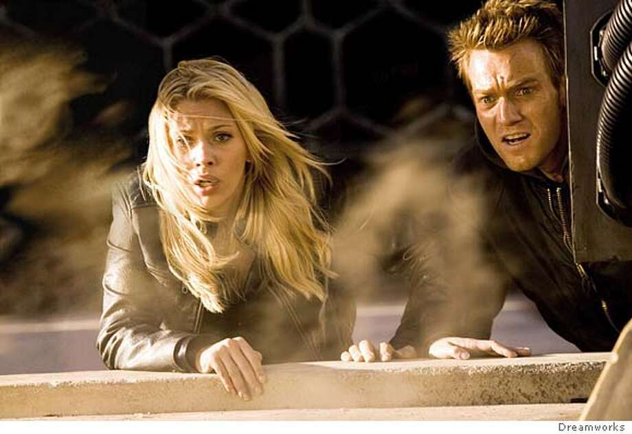 "In this undated publicity photo from Dreamworks Pictures' film ""The Island"", Ewan McGregor (R) and co-star Scarlett Johansson make a desperate attempt to escape from their contained community. In this futuristic action thriller Lincoln Six-Echo (McGregor) and Jordan Two-Delta (Johansson) are trying to escape from their contained community once they realize that everyone, including themselves, is a human clone with the sole purpose of providing spare parts for their original human counterparts. The movie opens in the United States on July 22, 2005. Doug Hyun/Dreamworks/Handout Photo: HO"