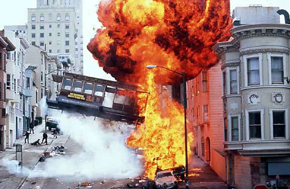 """A fiery shot from """"The Rock"""": Expect another cable car crash in """"The Hulk,"""" in theaters this summer. """"Metro"""" also featured a similar scene."""