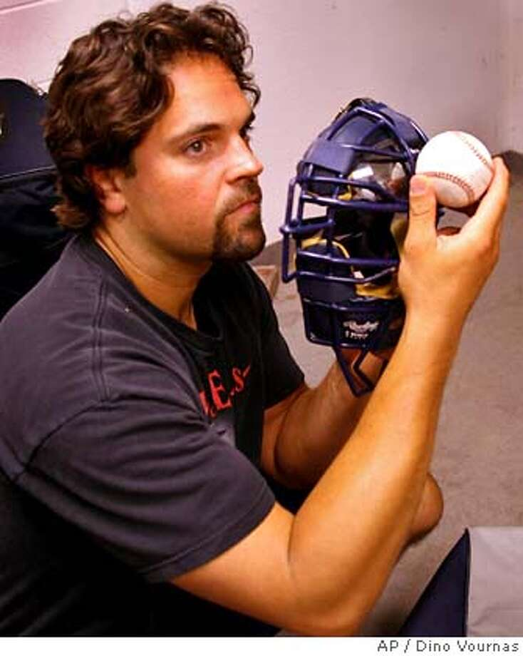 ** ADVANCE FOR THE WEEKEND OF AUG. 19-20 ** San Diego Padres catcher Mike Piazza shows the relationship of a ball striking a catcher's mask, Saturday, July 22, 2006, in San Francisco. (AP Photo/Dino Vournas)  Ran on: 08-20-2006  Mike Matheny ended his season due to concussion issues. His future is uncertain. ADVANCE FOR THE WEEKEND OF AUG. 19-20 Photo: DINO VOURNAS