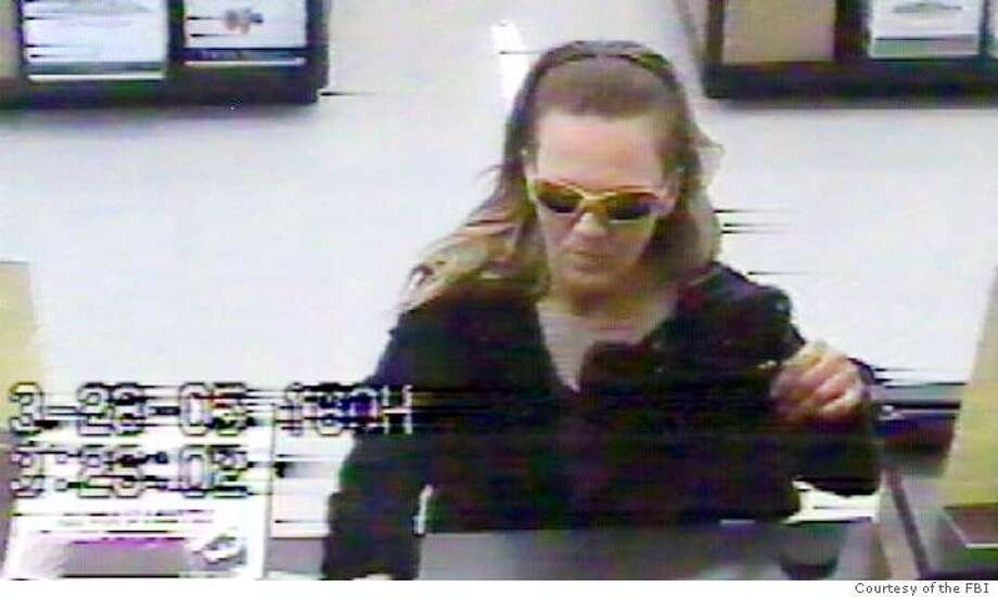 "Security camera image of the ""BAG LADY BANDIT."" Photo: Courtesy of the FBI Photo: Courtesy Of The FBI"