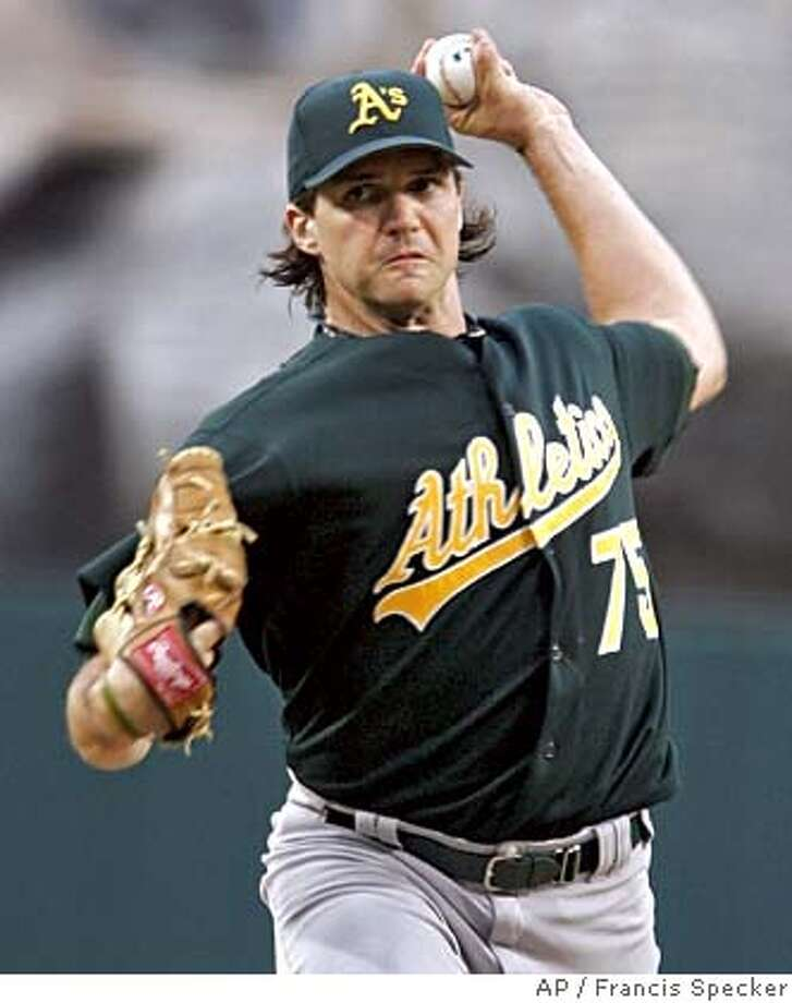 Oakland Athletics pitcher Barry Zito throws against the Los Angeles Angels in the first inning at Anaheim, Calif. on Wednesday, July 20, 2005. (AP Photo/Francis Specker) Photo: FRANCIS SPECKER