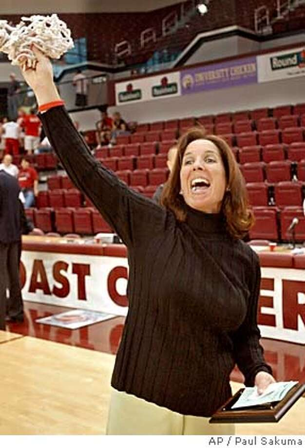 Santa Clara head coach Michelle Bento-Jackson waves the net after it was cut down, after Santa Clara upset Gonzaga 77-66 in the finals of the West Coast Conference Championship, Sunday, March 6, 2005 in Santa Clara, Calif. (AP Photo/Paul Sakuma) Ran on: 03-14-2005  A tourney invite is a net gain for Santa Clara coach Michelle Bento-Jackson, who respects Stanford. Ran on: 03-14-2005  A tourney invite is a net gain for Santa Clara coach Michelle Bento-Jackson, who respects Stanford. Photo: PAUL SAKUMA