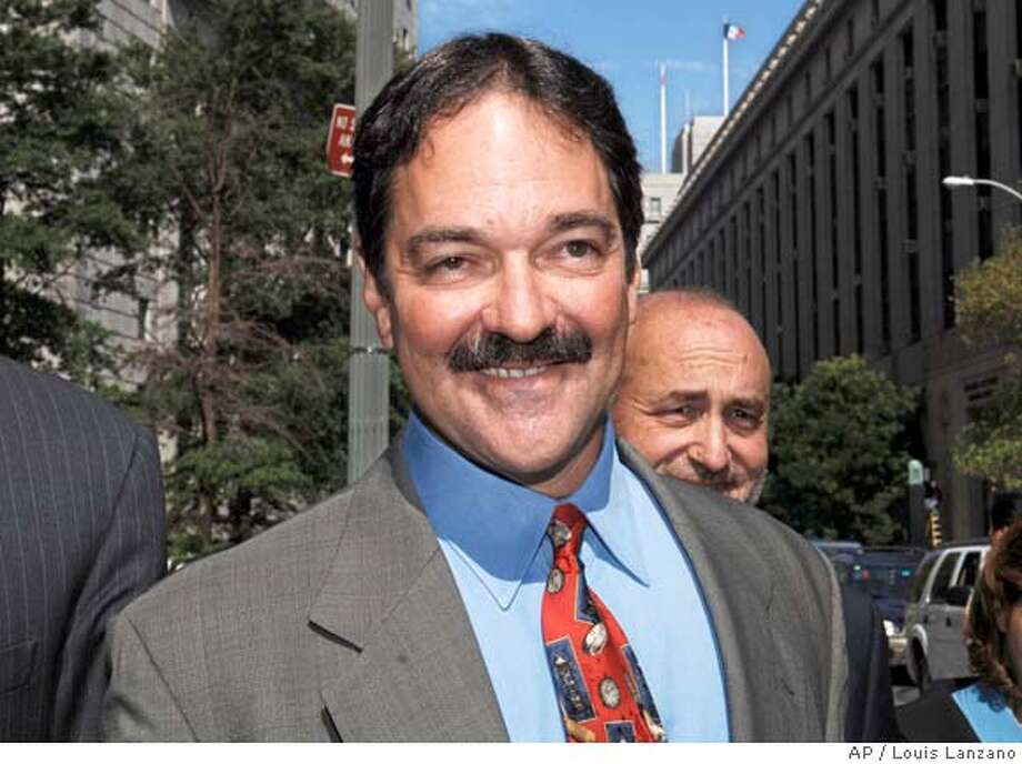 Former star technology banker Frank Quattrone exits Manhattan federal court with his attorney Mark Pomerantz, backround, Tuesday, Aug. 22, 2006, in New York. Quattrone reached a deal with the government Tuesday that allows his criminal case to be dismissed without a third trial. (AP Photo/ Louis Lanzano)  Ran on: 08-23-2006 Ran on: 08-23-2006 Photo: LOUIS LANZANO