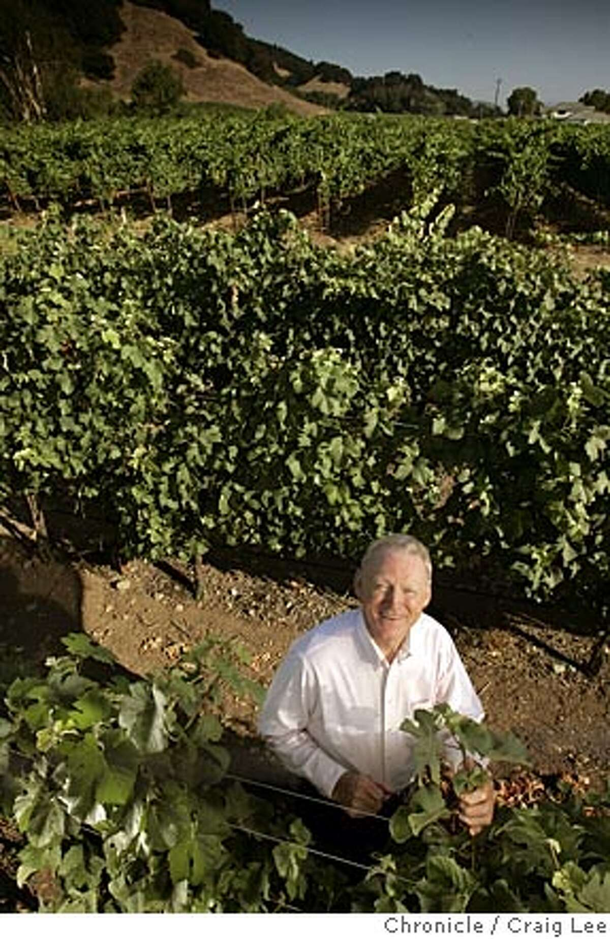 Photo of Dick Peterson, an eccentric and an inventor, and the Peterson dynasty, Heidi Barrett Peterson, his winemaker daughter and Holly Peterson, his chef daughter. Photo of Dick Peterson standing in his vineyard of Wrotham Pinot Noir in the foreground which is darker in color than his neighbor's Merlot in the background. Don't know if it really shows the difference in a photo. Event on 7/14/05 in Napa. Craig Lee / The Chronicle