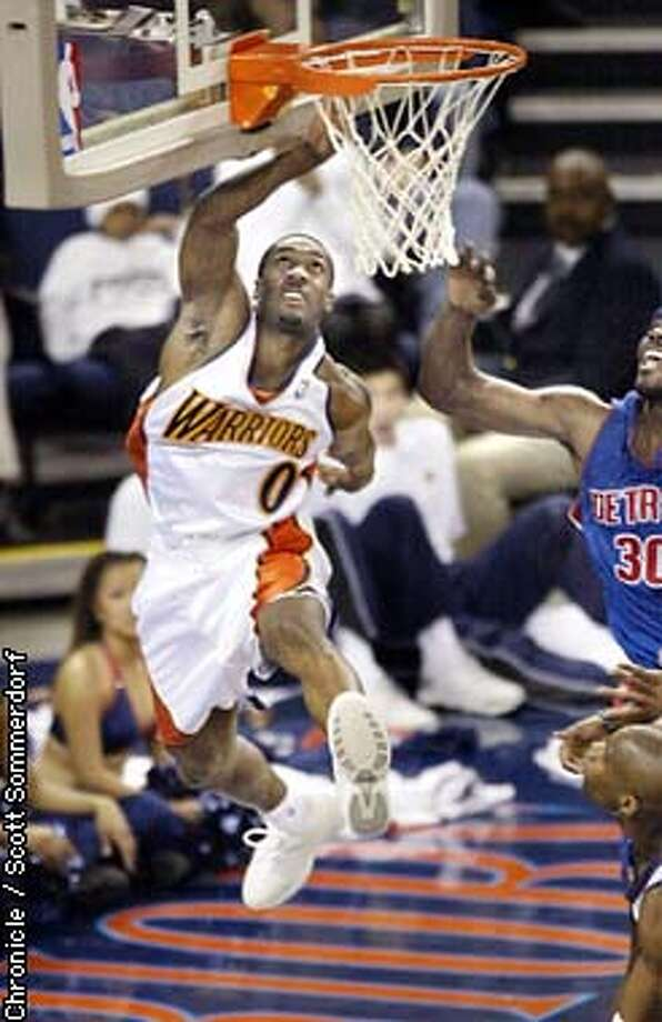 The Warriors Gilbert Arenas drives for a basket against the Detroit Pistons Saturday, March 1st, 2003. The Warriors won the game 92-90 to continue their unlikely run toward the NBA playoffs. SF CHRONICLE PHOTO BY SCOTT SOMMERDORF