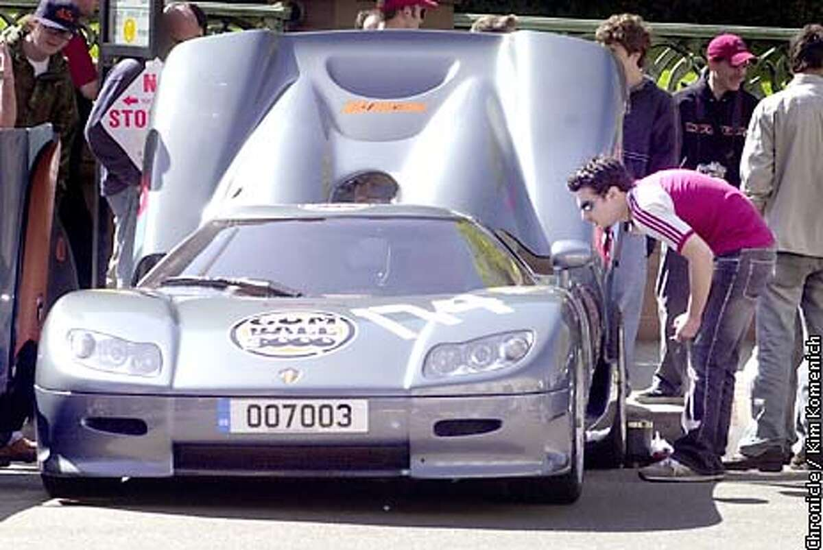 .jpg 4/17/03-San Francisco, CA Car fans ogle the Koenigegg CC85, $600,000 Swedish carthat will be in the race. The Gumball Rally, a high-end car race founded in England 5 years ago, makes its U.S. debut with a race from San Francisco to Miami. We attend the pre-race festivities at the Fairmont. Photo by Kim Komenich / The San Francisco Chronicle