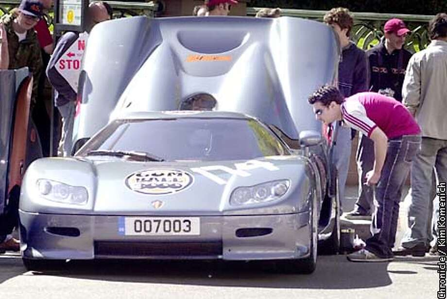 .jpg  4/17/03-San Francisco, CA  Car fans ogle the Koenigegg CC85, $600,000 Swedish carthat will be in the race. The Gumball Rally, a high-end car race founded in England 5 years ago, makes its U.S. debut with a race from San Francisco to Miami. We attend the pre-race festivities at the Fairmont.  Photo by Kim Komenich / The San Francisco Chronicle Photo: Kim Komenich