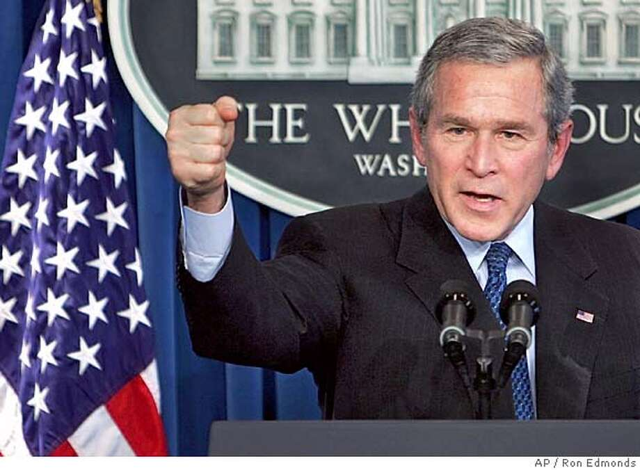 "President Bush told reporters, Wednesday, Jan. 26, 2005, that he is leading the nation toward an honorable goal in Iraq and across the world. ""I firmly planted the flag of liberty,"" he said during a press conference in the White House press room. (AP Photo/Ron Edmonds) Ran on: 01-27-2005  President Bush says the deaths of dozens of U.S. troops in Iraq Wednesday is discouraging but that &quo;spreading freedom&quo; is vital. Ran on: 01-27-2005  President Bush says the deaths of dozens of U.S. troops in Iraq Wednesday is discouraging but that &quo;spreading freedom&quo; is vital. Photo: RON EDMONDS"