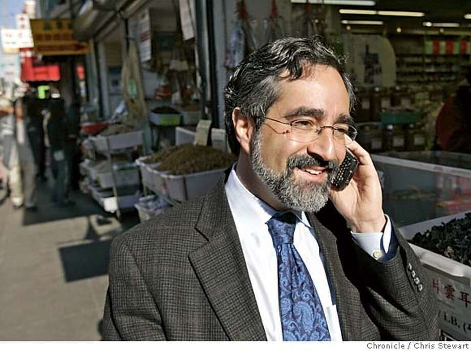 peskin06103_cs.jpg  Event on 12/3/04 in San Francisco.  San Francisco Supervisor Aaron Peskin works the phone while strolling through Chinatown. Peskin is soon to be elected to the position of board president. Peskin represents District 3, Chinatown and North Beach and likes to walk a beat to meet his constituents. Chris Stewart / The Chronicle MANDATORY CREDIT FOR PHOTOG AND SF CHRONICLE/ -MAGS OUT Photo: Chris Stewart