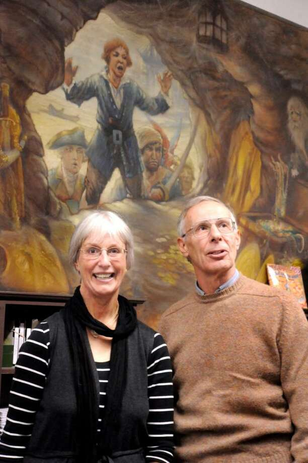 Barbara Meredith, 68, and her brother, Charles Federer III, 70, visiting Danbury to examine the murals their father Charles Federer painted, in the 1930's, on the walls of the Danbury Music Centre, on Friday, Oct.16,2009. Photo: Michael Duffy / The News-Times