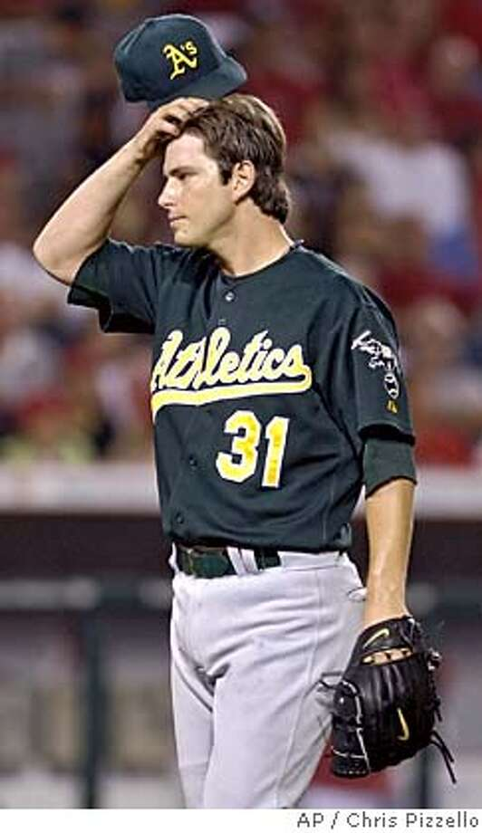 Oakland Athletics starting pitcher Kirk Saarloos departs the field after giving up four runs in the sixth inning against the Los Angeles Angels of Anaheim in Anaheim, Calif., Monday, July 18, 2005. (AP Photo/Chris Pizzello) Photo: CHRIS PIZZELLO