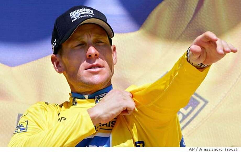 Overall leader Lance Armstrong, of Austin, Texas, pulls on the yellow jersey on the podium after the 16th stage of the Tour de France cycling race between Mourenx and Pau, southwestern France, Tuesday, July 19, 2005. (AP Photo/Alessandro Trovati) Photo: ALESSANDRO TROVATI