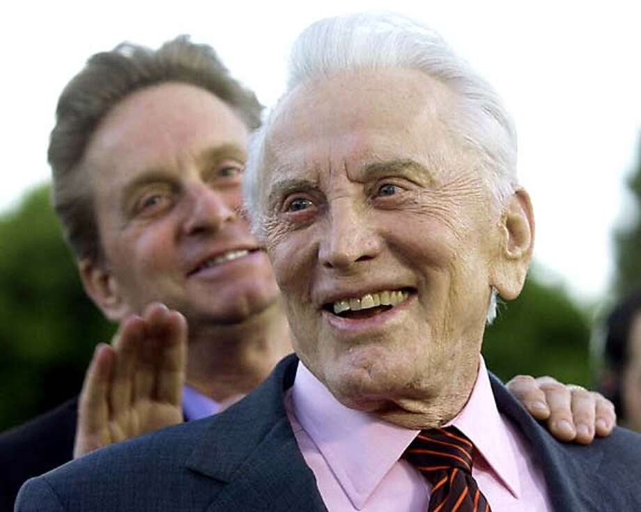 Kirk Douglas (foreground) with his son Michael. Associated Press photo by Chris Pizzello