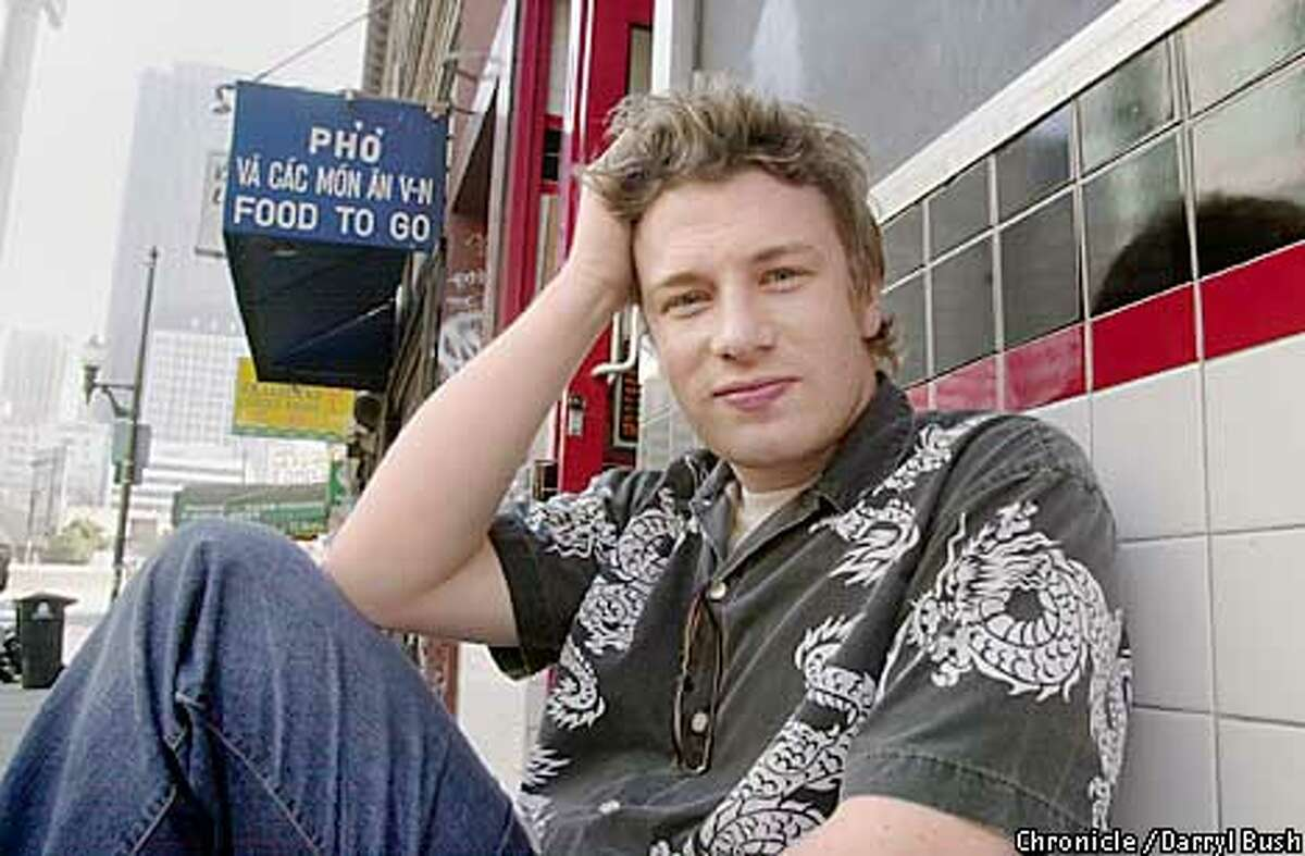 """Jamie Oliver of """"the Naked Chef"""" on Kearny in front of Nan King restaurant in China Town in San Francisco. CHRONICLE PHOTO BY DARRYL BUSH"""