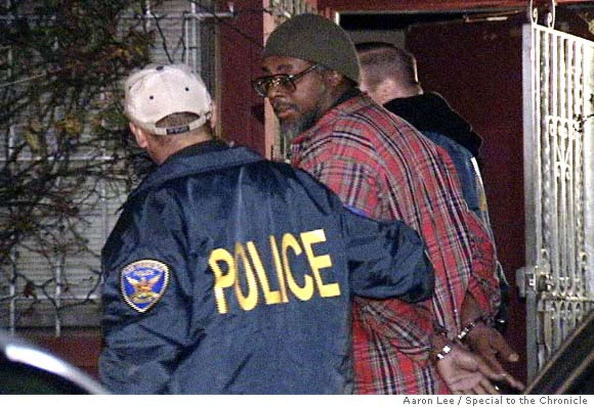 An alleged member of the Black Liberation Army is arrested Tuesday morning in front of 724 McAllister Avenue in San Francisco in connection with a 1971 shotgun murder of Sgt. John V. Young at the Ingleside Station. Special to The Chronicle / Aaron Lee