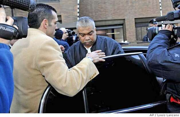 Francisco Torres is led by New York City detectives from One Police Plaza, Tuesday, Jan. 23, 2007, in New York. Torres was arrested in connection with the 1971 shooting death of police Sgt. John V. Young, 51 in San Francisco. (AP Photo/ Louis Lanzano) Photo: Louis Lanzano