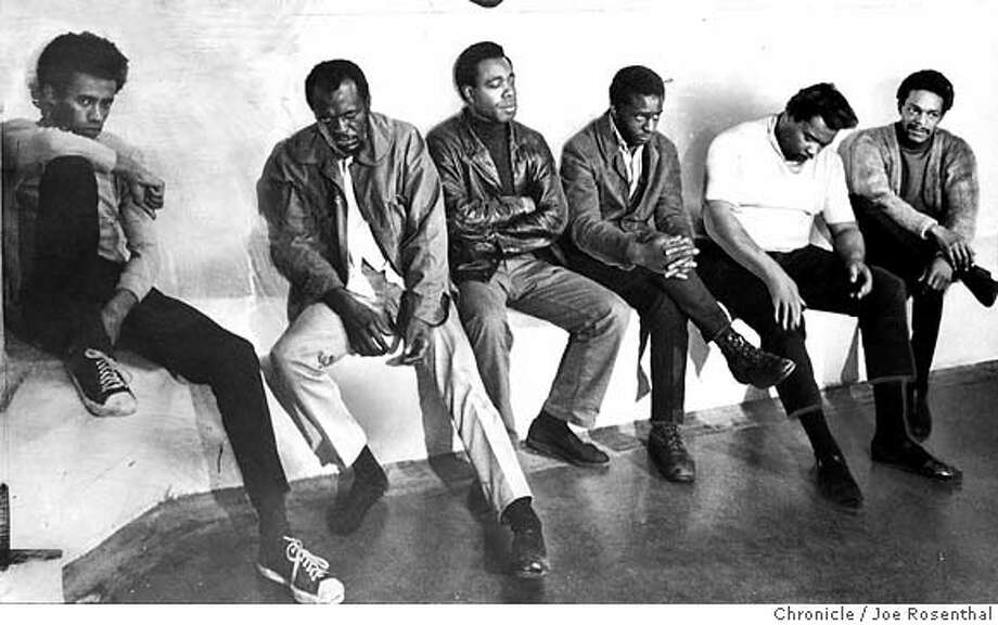"""BLACK PANTHERS4/19NOV68/JR - CAPTION AS IT RAN ON NOVEMBER 20, 1968:  """"Six of the shootout suspects waited to be booked at city jail. They are Samuel Napier William Lee Brent, Richard E. Brown, John Bowman, Wilfred Holiday and Raymond Lewis."""" It ran with a story head: """"Three Cops Hit in Shootout"""" and a deck, """"8 Black Militants Arrested After Duel."""" Caption on January 23, 2007: Richard E. Brown, third from the left, is also in custody and charged with the murder of a Sergeant Young and with conspiracy to murder police officers. Brown is currently 65. Brown is seen with (from L-R)Sameul Napier, William Lee Brent, ohn Bowman, Wilfred Holiday, and Raymond Lewis. All six were shootout suspects waiting to be booked at city Jail in 1968 after three cops were hit in a shootout. Photo by Joe Rosenthal/San Francisco Chronicle Ran on: 11-20-2006 Photo: JOE ROSENTHAL"""