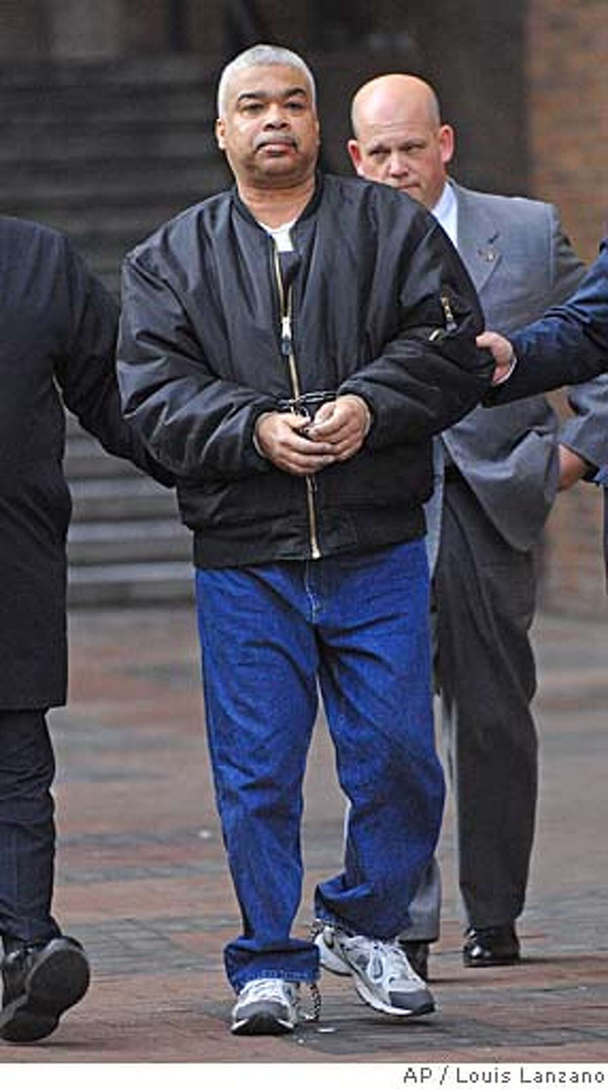 Francisco Torres is led by New York City detectives from One Police Plaza, Tuesday, Jan. 23, 2007, in New York. Torres was arrested in connection with the 1971 shooting death of police Sgt. John V. Young, 51 in San Francisco. (AP Photo/ Louis Lanzano)