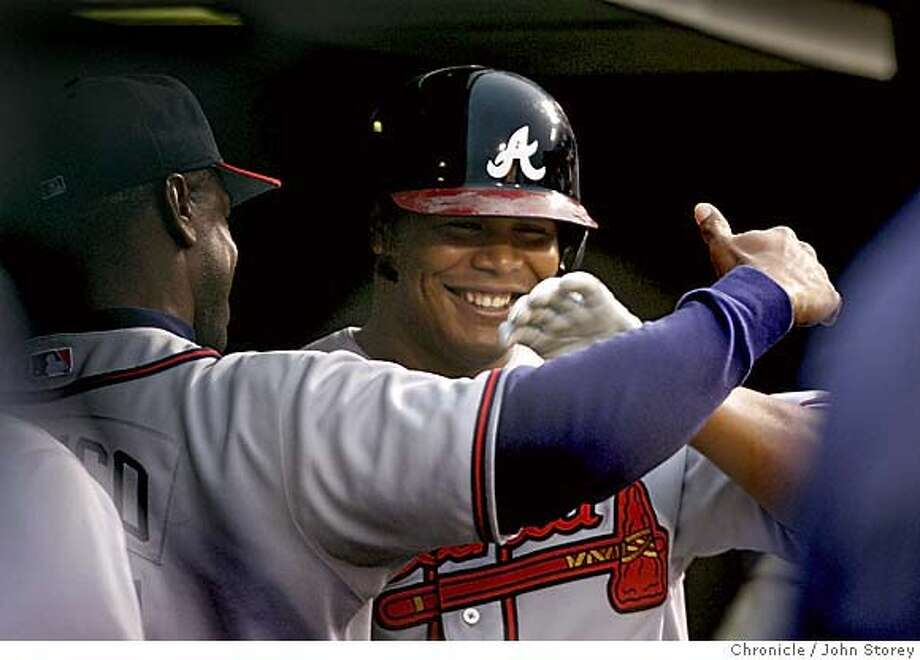 Andrwu Jones of the Braves in congradulated in the dugout after his 2nd two run home run in the 3rd inning. . The Giants vs. the Atlanta Braves at SBC Park. John Storey San Francisco Event on 7/18/05  - Photo: John Storey