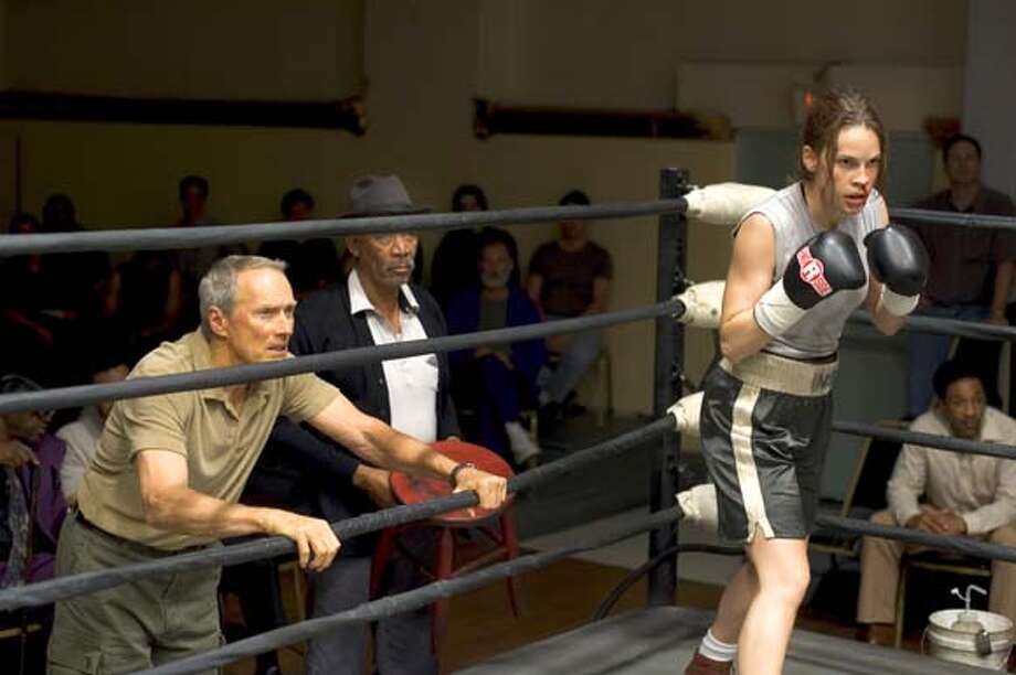 milliondollarbaby CLINT EASTWOOD as Frankie, MORGAN FREEMAN as Scrap and HILARY SWANK as Maggie in Warner Bros. Pictures� drama �Million Dollar Baby�, a Malpaso production. PHOTOGRAPHS TO BE USED SOLELY FOR ADVERTISING, PROMOTION, PUBLICITY OR REVIEWS OF THIS SPECIFIC MOTION PICTURE AND TO REMAIN THE PROPERTY OF THE STUDIO. NOT FOR SALE OR REDISTRIBUTION. Ran on: 12-25-2004  Frankie (Clint Eastwood) and Eddie (Morgan Freeman, center) watch Maggie (Hilary Swank) in the ring. Swank received a Golden Globe nomination for portraying Maggie, who wants to become a pro boxer. Ran on: 01-02-2005  Clint Eastwood, Morgan Freeman and Hilary Swank in &quo;Million Dollar Baby.&quo; Ran on: 01-02-2005  Clint Eastwood, Morgan Freeman and Hilary Swank in &quo;Million Dollar Baby.&quo; Ran on: 02-27-2005