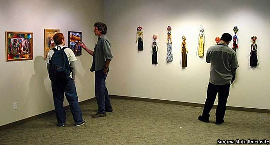 "A wall of puppets and various artworks are part of Sonoma State University's exhibit: ""Thinking about Freedom: Works From the San Quentin Arts Program.""  photos courtesy of Sonoma State University"