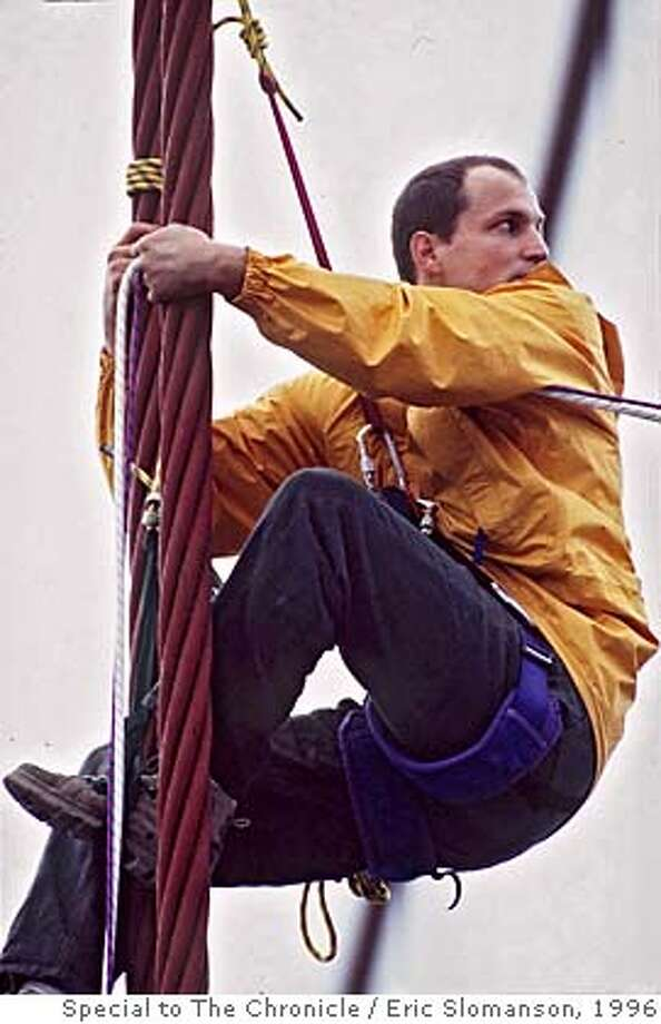 WOODY-BRIDGE/c/23NOV96/MN/FREE;ES ---- is shown climbing on the supports of the Golden Gate Bridge during a Headwaters protest on November 23rd. He was arrested with other demonstrators, and was arraigned for the offense today (1/14/97) in SF. FILE Photo / Special to The Chronicle by Eric Slomanson ALSO RAN: 6/30/97 Photo: ERIC SLOMANSON