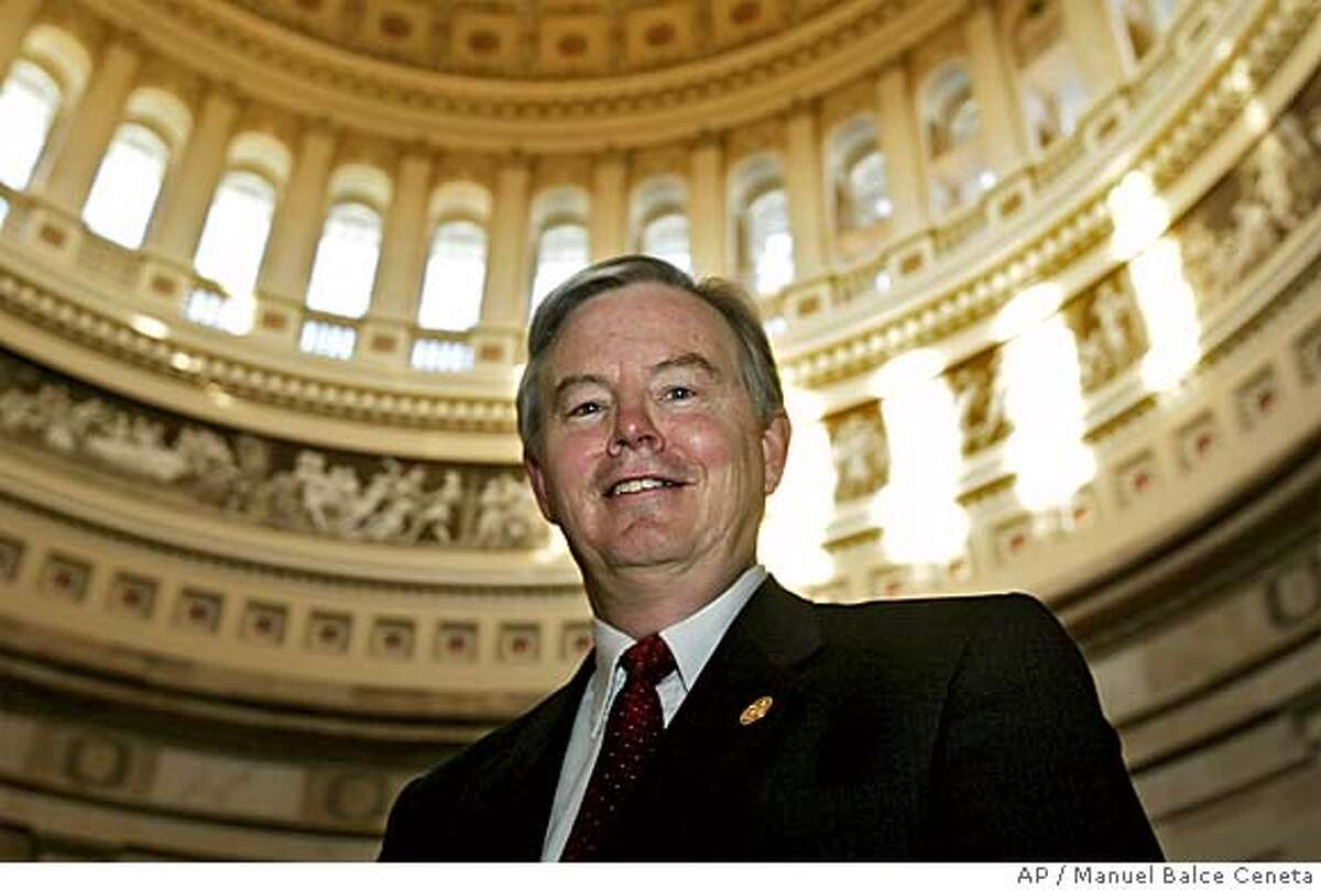 """** FILE ** In a file photo Rep. Joe Barton, R-Texas, poses at the Capitol Rotunda following a House Republican Steering Committee meeting on the Capitol Hill, Wednesday, Feb. 11, 2004, in Washington. Texas congressmen Joe Barton and Ralph Hall urged President Bush on Tuesday, June 28, 2005, to oppose a Chinese oil company's attempt to take over California-based Unocal Corp., arguing that """"this transaction poses a clear threat to the energy and national security of the United States."""" (AP Photo/Manuel Balce Ceneta) FEB. 11, 2004, PHOTO"""
