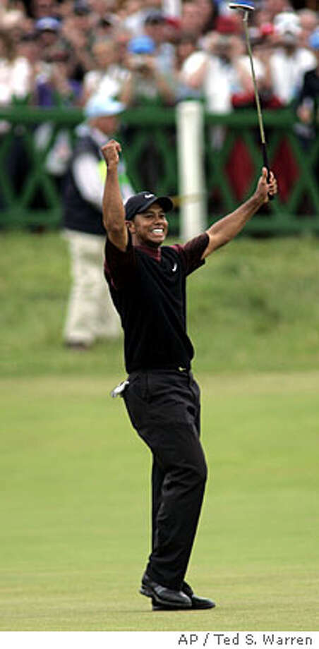 Tiger Woods reacts after sinking his final putt to win the British Open Golf Championship, on the Old Course at St. Andrews Scotland, Sunday July 17 , 2005. (AP Photo/Ted S. Warren) Photo: TED S. WARREN