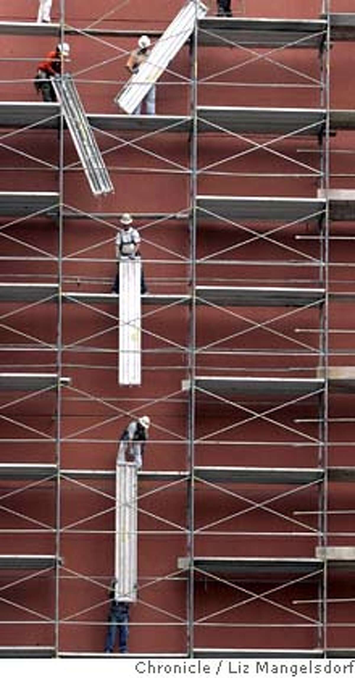scaffold042_lm.JPG Event on 7/18/05 in San Francisco. Employees of Safway(cq) Services remove their scaffolding on Jessie street near 5th street at the former Emporium store building. Liz Mangelsdorf / The Chronicle MANDATORY CREDIT FOR PHOTOG AND SF CHRONICLE/ -MAGS OUT