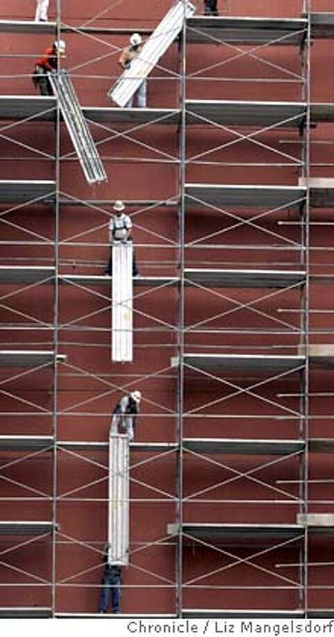 scaffold042_lm.JPG Event on 7/18/05 in San Francisco.  Employees of Safway(cq) Services remove their scaffolding on Jessie street near 5th street at the former Emporium store building. Liz Mangelsdorf / The Chronicle MANDATORY CREDIT FOR PHOTOG AND SF CHRONICLE/ -MAGS OUT Photo: Liz Mangelsdorf