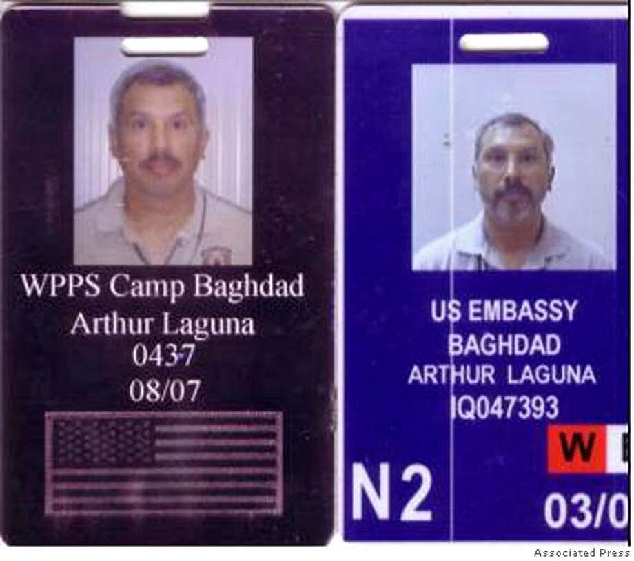 Photograph released by Ansar al-Sunnah Army, an Iraqi insurgent group, shows ID badges of Arthur Laguna, a 52-year-old pilot for Blackwater, a U.S. security company. Laguna's helicopter crashed as it flew over a dangerous Sunni neighborhood in the central Baghdad, Iraq, Tuesday Jan. 23, 2007. A U.S. official said five American civilians on board were killed. (AP Photo) PHOTO PROVIDED ANSAR AL-SUNNAH ARMY Photo: AP Photo