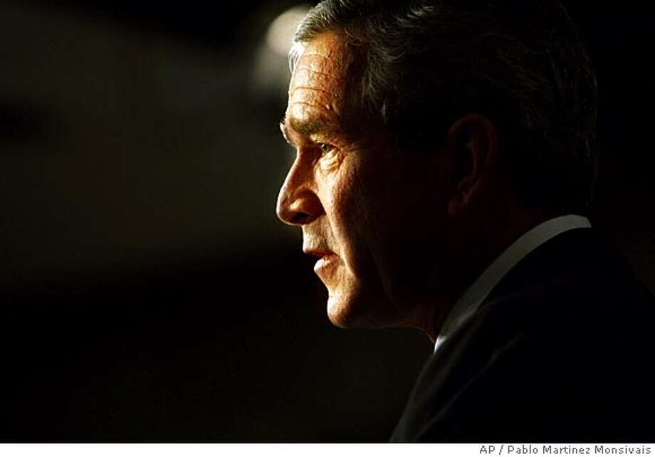 President Bush answers questions during his presss conference at the Eisenhower Executive Office Building of the White House, Thursday, Nov. 4, 2004 in Washington. (AP Photo/Pablo Martinez Monsivais) Ran on: 11-06-2004  Photo caption Photo: PABLO MARTINEZ MONSIVAIS