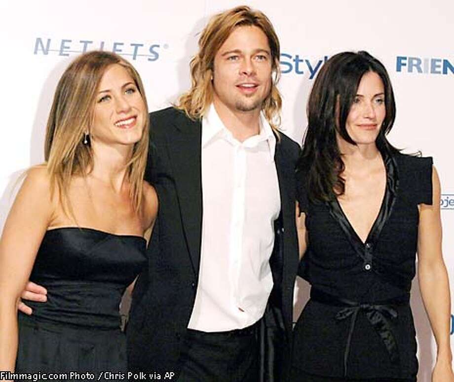 "From left, Jennifer Aniston, Brad Pitt, and Courtney Cox Arquette gather for the Project A.L.S. ""Friends Finding A Cure"" Gala honoring Producer Brad Grey at the Regent Beverly Wilshire Hotel in Beverly Hills, Calif., Monday, April 14, 2003. (AP Photo / Filmmagic.com Photo / Chris Polk via AP) Photo: CHRIS POLK"